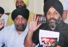 DSGMC president Manjit Singh G.K. with senior vice-president Ravinder Singh Khurana addresses a press conference in New Delhi