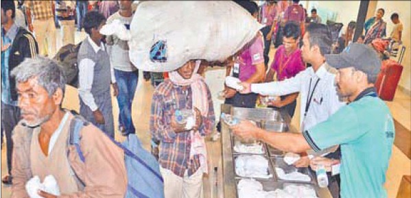 Food being served to flood victims at the Amritsar airport on