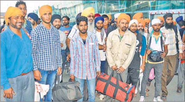 People who were airlifted from Srinagar, after landing at Sri Guru Ramdass Jee Airport in Amritsar on