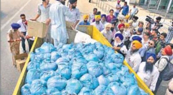 SGPC president Avtar Singh Makkar watching the loading of relief material for Srinagar, in Amritsar on Wednesday.