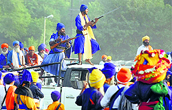 Armed supporters of a Nihang group during a clash in Amritsar