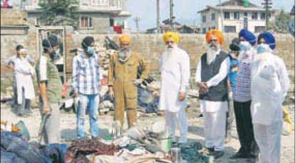 Members of a Shiromani Gurdwara Parbandhak Committee team assessing the losses suffered by flood-hit Sikh families in Srinagar
