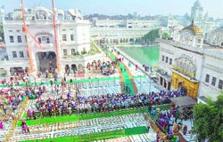 Devotees wait in a queue to pay obeisance at the Golden Temple on Thursday.