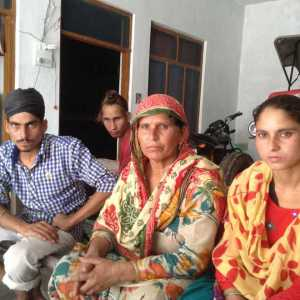 "Sukhwant Kaur, whose brothers-in-law were among 28 beaten up in jail, with family. One died, other was injured and shifted to Amritsar after release; her husband died of heart attack, ""pained by all this""."