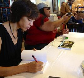 Sikivu Hutchinson signing and selling copies of her latest book.