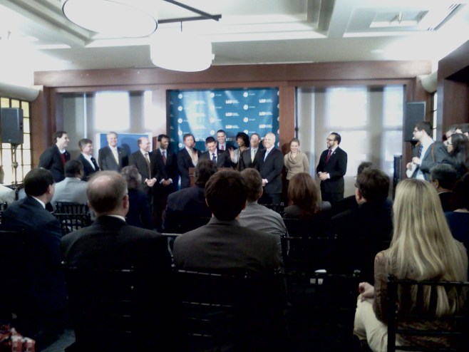 Michael Hecht, CEO and GNO, Inc. addresses the audience at the IP Building in New Orleans, flanked by Governor Bobby Jindal, Mayor Mitch Landrieu and Senator David Vitter.