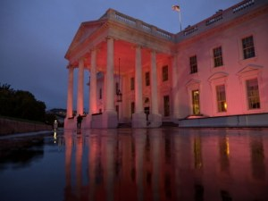 The North Portico exterior of the White House is illuminated pink in honor of Breast Cancer Awareness Month, Oct. 15, 2014. (Official White House Photo by Chuck Kennedy)