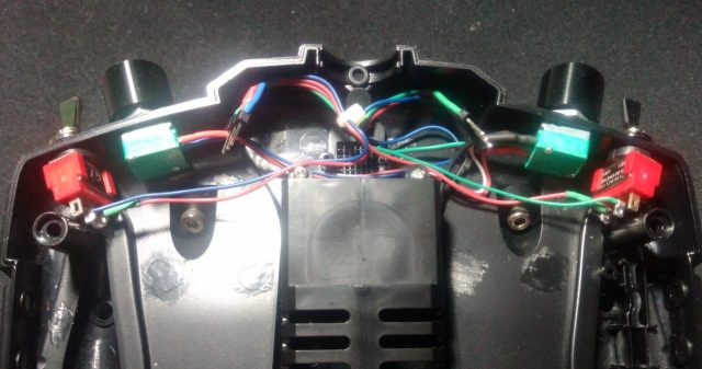 Two 2-way switches on rear cover connected via 3 pin connector.