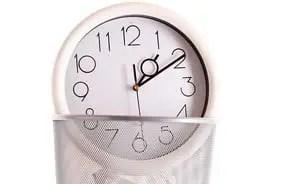 Clock in trash, lost time concept