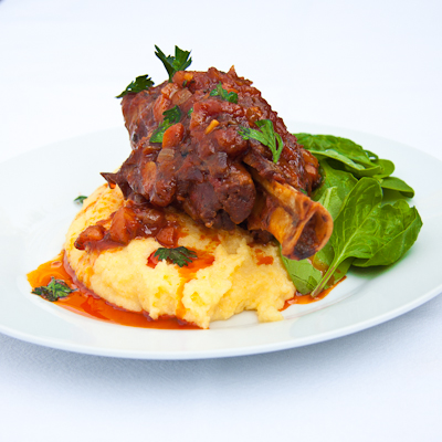 Tomato Braised Lamb Shanks on Polenta - Simply Delicious