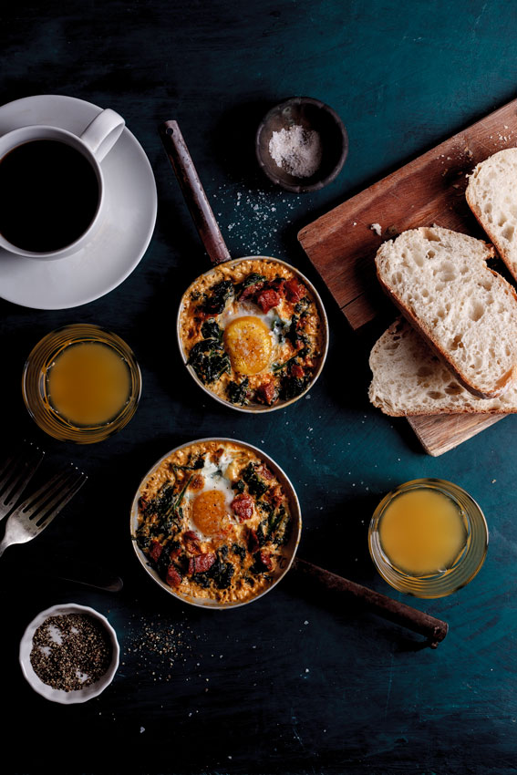 Baked eggs with spinach, chorizo and feta