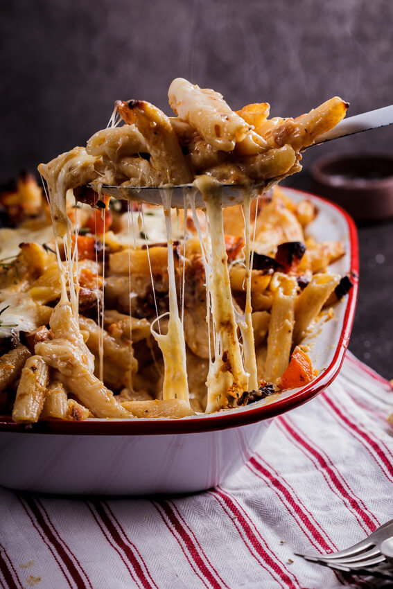 Creamy penne pasta bake studded with cubes of sweet, roasted butternut squash and chunks of buffalo mozzarella, flavored with fresh thyme.