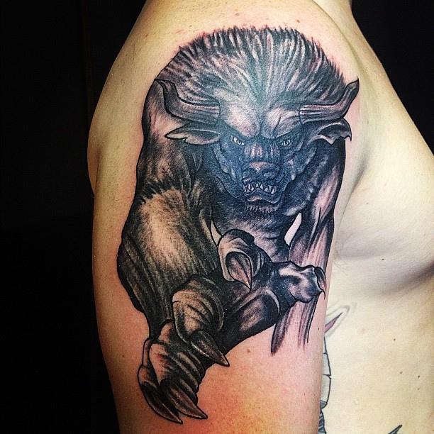 black bull tattoo design on shoulder