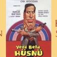 Yine bir Natuk Baytan, yine bir Kemal Sunal ve yine bir mahallelinin evlerinin paragöz bir adamın elinden kurtarılmasına arka plan bir film: Yedi Bela Hüsnü