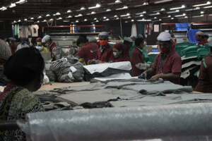 Workers at a knitwear factory in Bangladesh. (Image Credit: NYU Sterns BHR/FlickrCC)