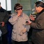Kim Jong Il at the Hoeryong Taesong Cigarette Factory