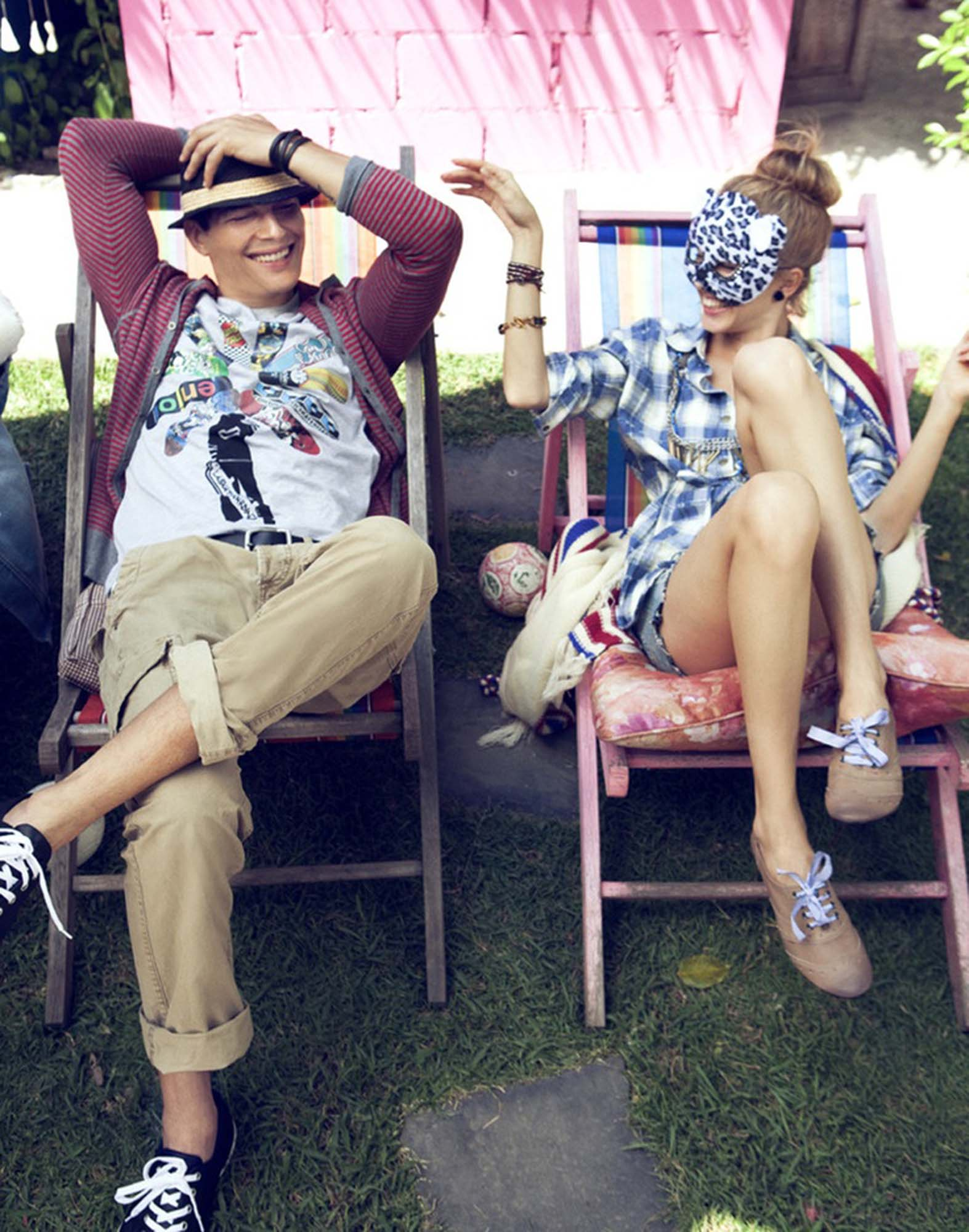 Man and woman sitting in lounge chairs in the yard