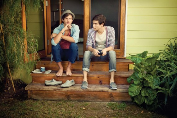 Two men sitting on the front porch