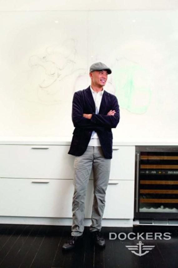 Man standing next to a white desk