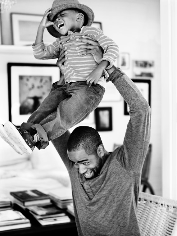 Dad putting son on his shoulders