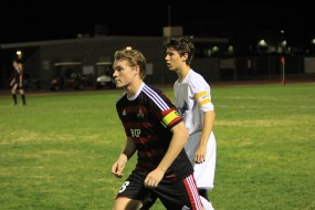 Senior Eric Stelzer helps Brophy's defense.