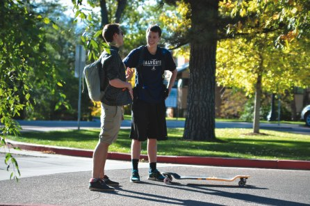 Two students stop and chat before they head off to class.