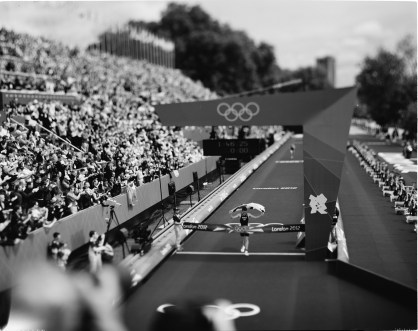"""Summer Olympics, London, 2012 Burnett catches this image of Britain's Alistair Brownlee winning gold in the Hyde Park men's triathlon with a time of 1 hour, 46 minutes, 25 seconds. Burnett says most of his Olympic photo subjects """"are anything but the gold medalists."""""""