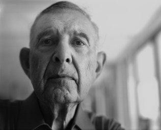 """Harold Baumgartner, St. Augustine, Florida, 2004 Burnett first began photographing World War II D-Day veterans in 1974. This image features Harold Baumgartner, who was wounded five times on June 6, 1944. These reunions in particular offer Burnett opportunities to reflect. He says, """"You keep putting these little markers down in your life, and I started to really understand that the first time in 1974, when I was — what? 27 — and I attended the first of what would become many D-Day reunions up in Normandy."""""""