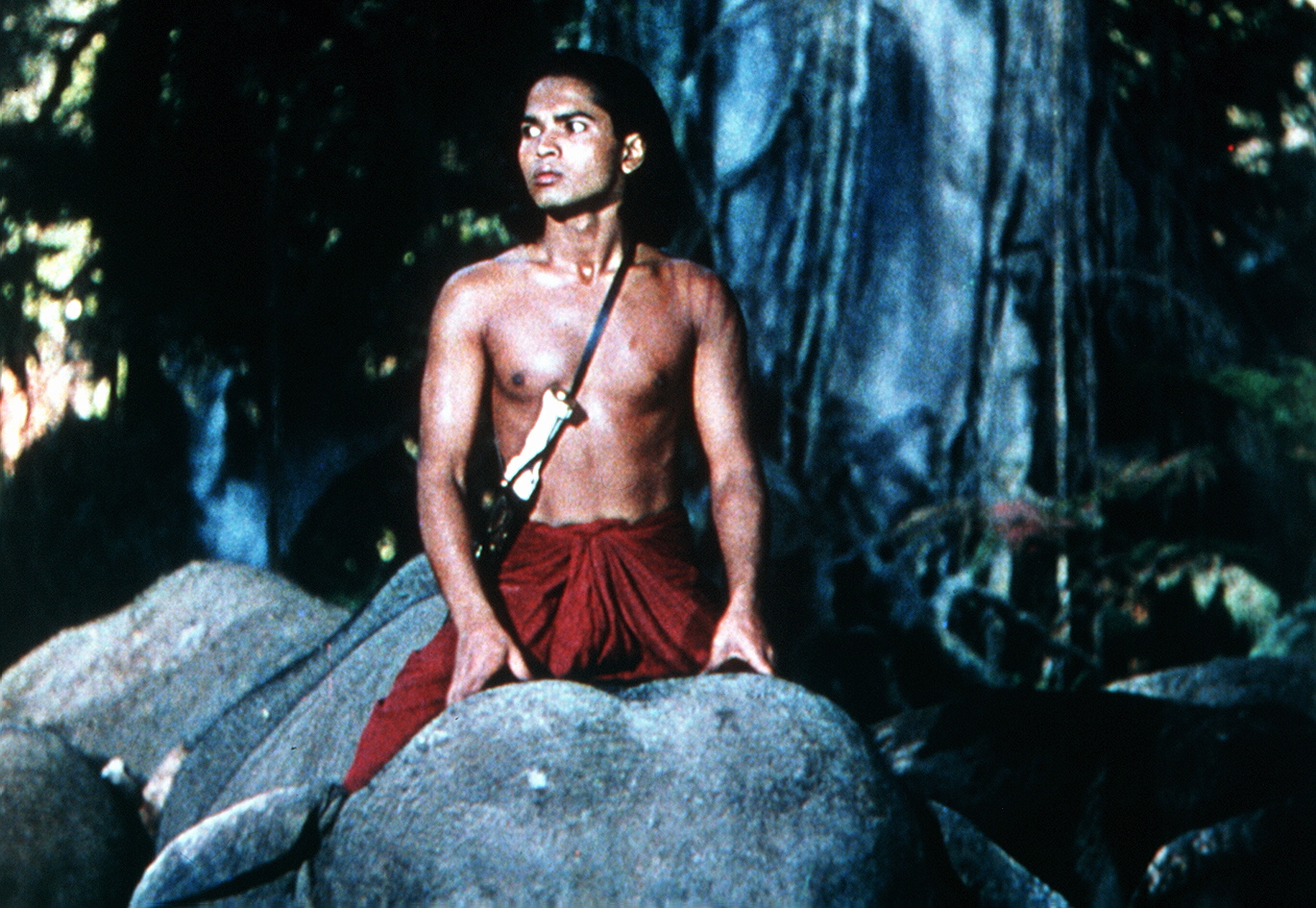 MOWGLI (SABU) SITS ON TOP OF AN ELEPHANT *** Local Caption *** Feature Film