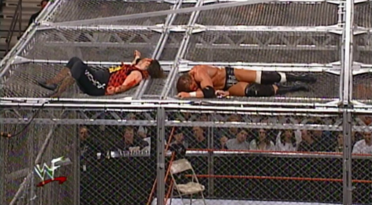 triple_h_vs_cactus_jack_hell_in_a_cell