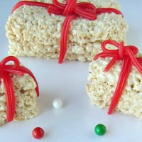 Christmas Rice Krispie treats are a cute & easy dessert to serve at any Christmas party. Adults & kids are sure to love them with a surprise candy inside.
