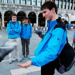 """Junior David Stewart held food for pigeons in St. Mark's Square in Venice, Italy. """"It was just a weird feeling having pigeons fly all over you. It was fun and crazy,"""" Stewart said. Photo by Molly Howland."""