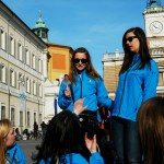 """Senior Sarah Johnston (right) brought two pictures of Senora Sieck on the trip. She and senior Libby Wooldridge """"took them all over Italy. We took a bunch of pictures in different places that we went so it was like she was there,"""" Johnston said. Photo by Molly Howland."""
