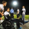 Senior Bennett Wendlant pushes teammate Senior David Sosna who was in a wheelchair due to knee surgery earlier in the week. Photo by Jake Crandall