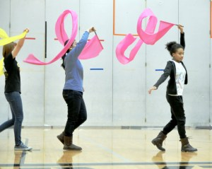 Chinese students practice a performance for the Chinese New Year.