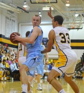 Senior Zach Schnieder goes up against a SM West player.  Photo by Maddie Schoemann