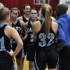 J.V.  girls gather in a team huddle. Photo by Tessa Polaschek