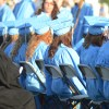 Students wait in anticipation for their diploma. Photo by Neely Atha