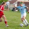 Freshman Chloe Harrington gets ready to make a move past a North player. Harrington is one of three freshman who made the varsity team. Photo by Mike Thibodeau