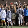 East fans surround their team and cheer for them at the conclusion of the game. Photo by McKenzie Swanson