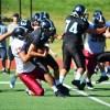 A Lawrence lineback tackles junior quarterback Gunnar Englund. Photo by Julia Poe.