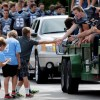 Senior Jake McDonald give a boy a high five during the parade. Photo by Mckenzie Swasnon