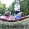 Senior Molly Ross pushes her friends on the hammock at the carbo load. Photo by Neely Atha