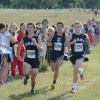 Senior Spencer Jones, Ben Wickey, and Nick Steiner sprint towards the end of the c team race. Photo by Neely Atha