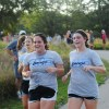 Senior Sara Benson and junior Sydney Bahr finish out the last leg of their run. Photo by Julia Poe