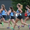 A pack of East runners start out the race together. Photo by Neely Atha