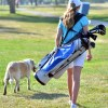 Freshman Courtney McClelland walks alongside a dog at the course. Photo by Tessa Polaschek