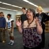 Sra. Rosa Detrixhe dances as her students teach how to do the conga. Photo by Maxx Lamb