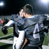 After the student section clears off the field, senior Ryan Carter congratulates fellow captain Mitchell Tyler one last time. Photo by Marisa Walton