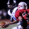 Junior quarterback Gunnar Englund looks to hand off the play. Photo by Marisa Walton